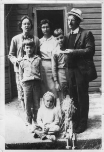 James Reaney and family in 1965 in Leith, Ontario. Standing left to right are the adults: Colleen Reaney, Wilma McCaig (Jamie's sister), and James Reaney. The children are John Andrew Reaney, James Stewart Reaney, and Susan Reaney (beside Applebutter). Photo by Jay Peterson.