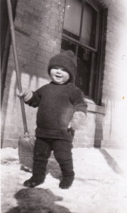 James Reaney, age 1 1/2 years, on his front porch, January 1928.