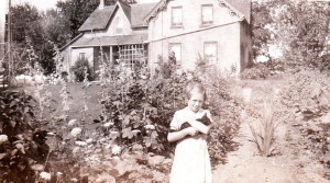 Summer 1937 -- James Reaney's cousin Kathy Smith by the front garden (ECR)